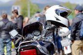 image of motorcycle  - Motorcycle helmet hanging on the handlebars of a motorcycle - JPG