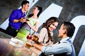 picture of flirt  - Two Asian young and handsome party people couples flirting and drinking at the bar in luxurious and fancy night club - JPG