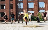 picture of rap-girl  - Young Girl hip hop dancing in an urban square with her friends supporting her - JPG