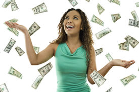 stock photo of save money  - Stock image of woman standing with open arms amidst falling money - JPG