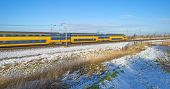 foto of passenger train  - Passenger train in a snowy landscape in winter - JPG