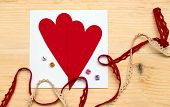 foto of card-making  - scrapbook background. Card and tools with decoration. valentine