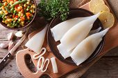 picture of squid  - Preparation of raw squid and ingredients on the table - JPG