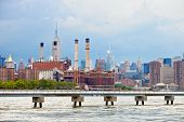 picture of empire state building  - New York City USA industrial factory plant in the city with downtown Manhattan buildings in the background - JPG