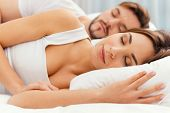foto of sleeping beauty  - Beautiful young loving couple sleeping together in bed - JPG