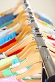 pic of clothes hanger  - Clothes on hangers in store - JPG