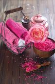 stock photo of salt-bowl  - Spa setting with sea salt towels and flower on painted wooden boards - JPG