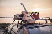 pic of racks  - Vintage musical rusty grunge car luggage rack on the sea shore - JPG