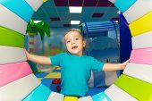 stock photo of little boys only  - little boy playing in the entertainment center - JPG