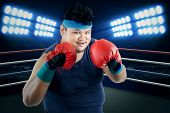picture of boxing ring  - Overweight man ready to boxing on the ring - JPG