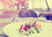 pic of tartar  - Tuna tartar with cucumber and orange on restaurant table - JPG
