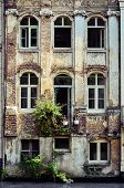 foto of gents  - Old weathered wall with vintage windows Gent Belgium - JPG