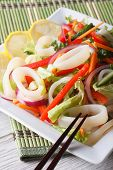 foto of squid  - Salad with vegetables and squid rings close - JPG