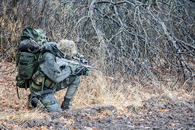 stock photo of raid  - Jagdkommando soldier Austrian special forces equipped with assault rifle during the raid - JPG