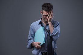 foto of unemployed people  - Crying untidy businessman looking down business failure and unemployment concept - JPG
