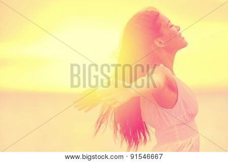 Happiness - Free happy woman enjoying sunset. Beautiful woman in white dress embracing the golden su