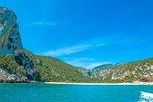 stock photo of shoreline  - Cala Gonone shoreline on a clear day Sardinia - JPG