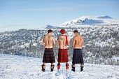 foto of peeing  - Three men peeing on the top of the mountain - JPG