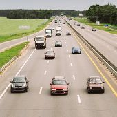 picture of speeding car  - Busy Highway During Day - JPG