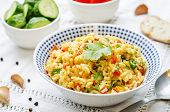 picture of saffron  - saffron rice with vegetables and cilantro on a white background - JPG