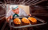 pic of oven  - Chef prepares pastries in the oven - JPG