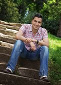 stock photo of stairway  - Beautiful young man sitting on stairway outdoor  - JPG
