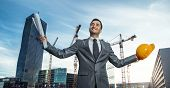 stock photo of clever  - Successful engineer or architect crane and building construction at backgrpound - JPG