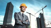 stock photo of construction crane  - Successful engineer or architect crane and building construction at backgrpound - JPG