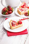 picture of custard  - Strawberry tart with custard on the table - JPG