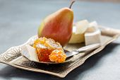 stock photo of brie cheese  - Honey pear and brie cheese on a bronze tray - JPG