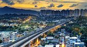 picture of high-speed train  - hong kong urban downtown and sunset speed train - JPG