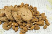 image of decoupage  - Decoupage table covered with raw almonds and integral cookies - JPG