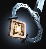 pic of microchips  - Claw robotics holding a microchip - JPG
