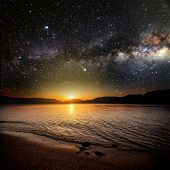 picture of reflection  - month on a background star sky reflected in the sea - JPG