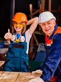 foto of millwright  - Happy woman and young woman  in builder uniform thumb up - JPG