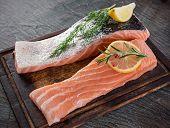 stock photo of salmon steak  - Delicious salmon steak on stone table - JPG