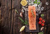 foto of salmon steak  - Delicious salmon steak on wooden table - JPG