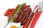 pic of red meat  - roast red beef meat fillet with red hot pepper with ketchup mayonnaise and mustard on plate isolated on white background - JPG