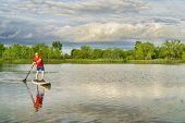 picture of stand up  - senior male on stand ups paddleboard  - JPG