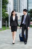 picture of carry-on luggage  - Businessman carry luggage for his business trip with his colleague - JPG