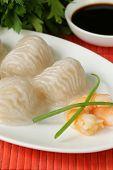 foto of soy sauce  - Asian steamed meat dumplings dim sum with soy sauce  - JPG