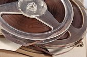 picture of magnetic tape  - Old vintage bobbins with magnetic tapes close up - JPG