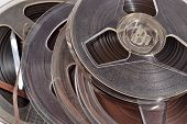 image of magnetic tape  - Old vintage bobbins with magnetic tapes close up - JPG