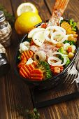 foto of redfish  - Fried fish with vegetables in the pot  - JPG