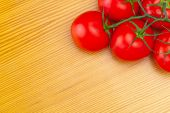 picture of neat  - Bunch of neat red tomatoes on wooden table  - JPG