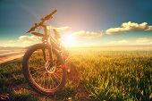 foto of descending  - Mountain biking down hill descending fast on bicycle - JPG