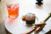 stock photo of ginger bread  - Rhubarb and ginger muffins on white plate - JPG