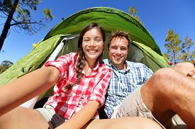 image of camper  - Selfie camping people in tent taking self portrait using camera smartphone - JPG