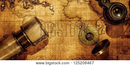 poster of Old vintage retro compass and binoculars on ancient world map. Vintage still life. Travel geography navigation concept background.