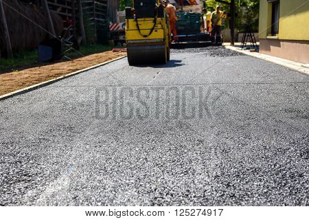 Team Of Workers Making And Constructing Asphalt Road Construction.